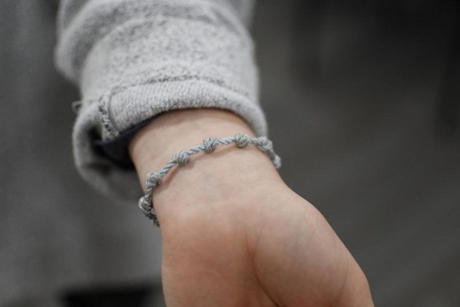 As an expression of her individual faith, Sara Pavlyak wears a rosary bracelet representing her Christian values.