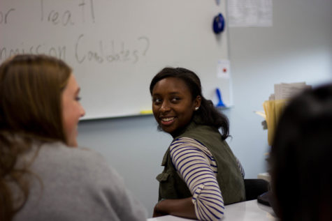 Senior Laila Robinson smiles as another club member shares an idea. Many of the Young Dems meetings are discussion-oriented, giving students a chance to share their ideas and opinions.