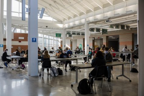 Following the Pre-ACT, freshmen sit waiting in the Commons before touring the building. For many, this was their first time being in Free State.