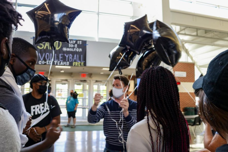 Staff and students prepare to release balloons in honor of Dee Kemp